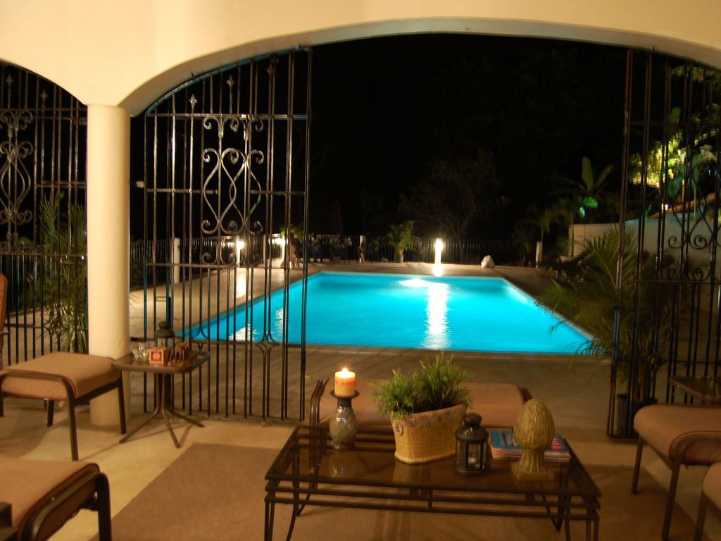 Pool 1 at Night from Patio Perspective
